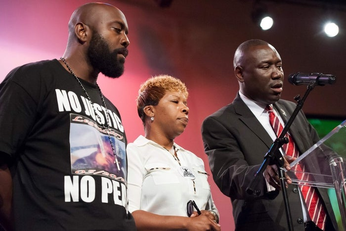 Lesley McSpadden (center) and Michael Brown Sr. (left), parents of 18-year-old Michael Brown.