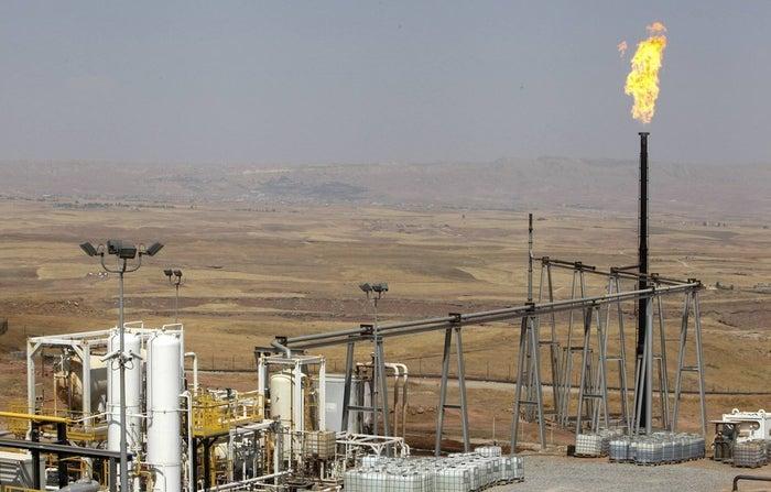 A flame rises from a chimney at Taq Taq oil field in Irbil.