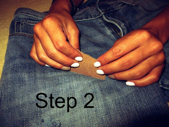 Step 2: Rub the sandpaper on the area where you want your hole to be. Depending on the thickness of your jeans you may have to spend a while sanding.