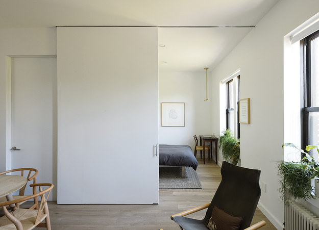 Replace doors with sliding walls to let your space breathe.