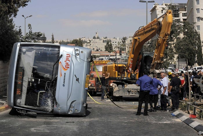 An overturned bus at the scene of a suspected attack in Jerusalem.