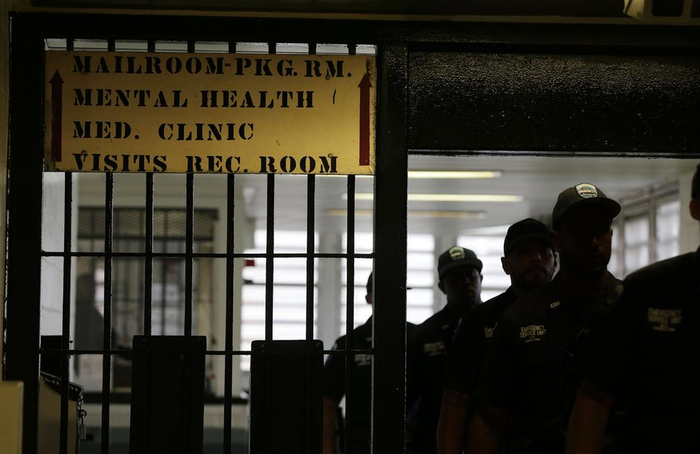 Rikers Island emergency services personnel walk through one of many gates inside the jail's juvenile detention facility in New York.