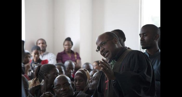 Anti-LGBT activist Martin Ssempa speaks to the court room before Friday's ruling striking down the Anti-Homosexuality Act.