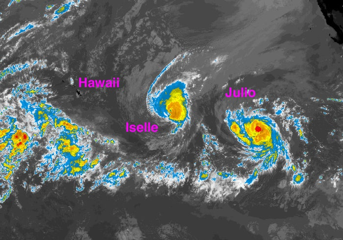 An infrared satellite image taken Tuesday afternoon shows Hurricane Iselle and Tropical Storm Julio in the Pacific Ocean, east of Hawaii.