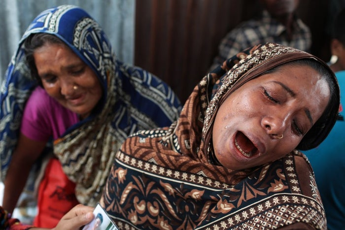 A Bangladeshi woman cries for her missing mother following the capsize.