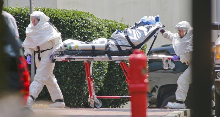 Medical workers bring Nancy Writebol, a missionary who had been working at a Liberian hospital, into Emory University Hospital in Atlanta on Tuesday.