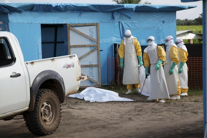 Health workers, wearing head-to-toe protective gear, prepare for work, outside an isolation unit in Foya District, Lofa County, Liberia in this July 2014 UNICEF handout photo.