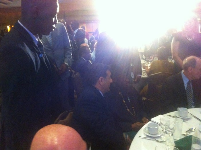 This blurry photo shows Micheal Ighodaro (left) approaching President Goodluck Jonathan (center).