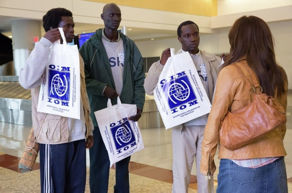 Emmanuel Jal, Ger Duany, Arnold Oceng, and Reese Witherspoon in The Good Lie