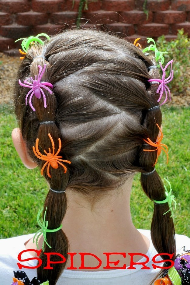 For a little added Halloween festivity, thread spider rings onto a little girl's pigtails.