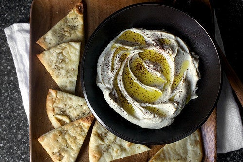 Making your own hummus is basically simple — throwing a handful of ingredients in a food processor and pressing the button — but to get that super smooth texture you have to remove the chickpeas from their skins. It's not particularly fun but it's mindless enough that you can do it while you're on the phone or watching TV. Recipe for the perfect hummus here. Want to spice things up? Try a smoky, sweet potato version or a protein-packed edamame hummus.
