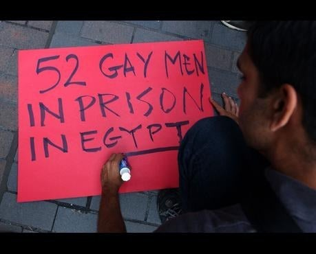 A protestor in New York makes a sign denouncing the arrest of more than 50 in the Queen Boat case, August 15, 2001.
