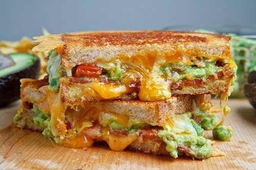 EXCUUUSE ME?! Crunchy chips, melty cheese, guacamole, and bacon. Is this the real life? Is this just fantasy? Get the recipe here.