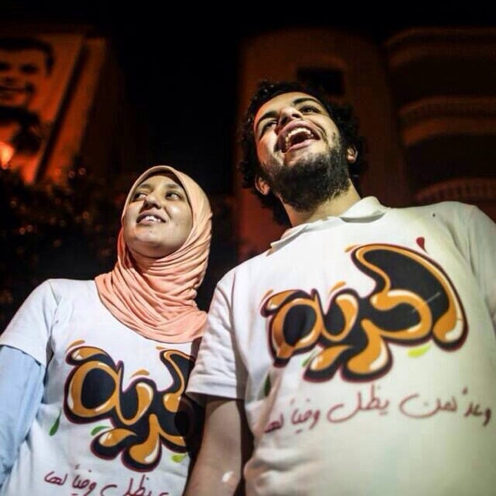 "Abdullah al-Shamy with his wife, Gehad Khaled, after his release in June. Their t-shirts say, ""Freedom."""