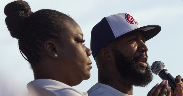 Sybrina Fulton (left) and Tracy Martin, parents of Trayvon Martin, speak at the Peace Fest rally in St. Louis, Missouri, on Aug. 24, 2014.