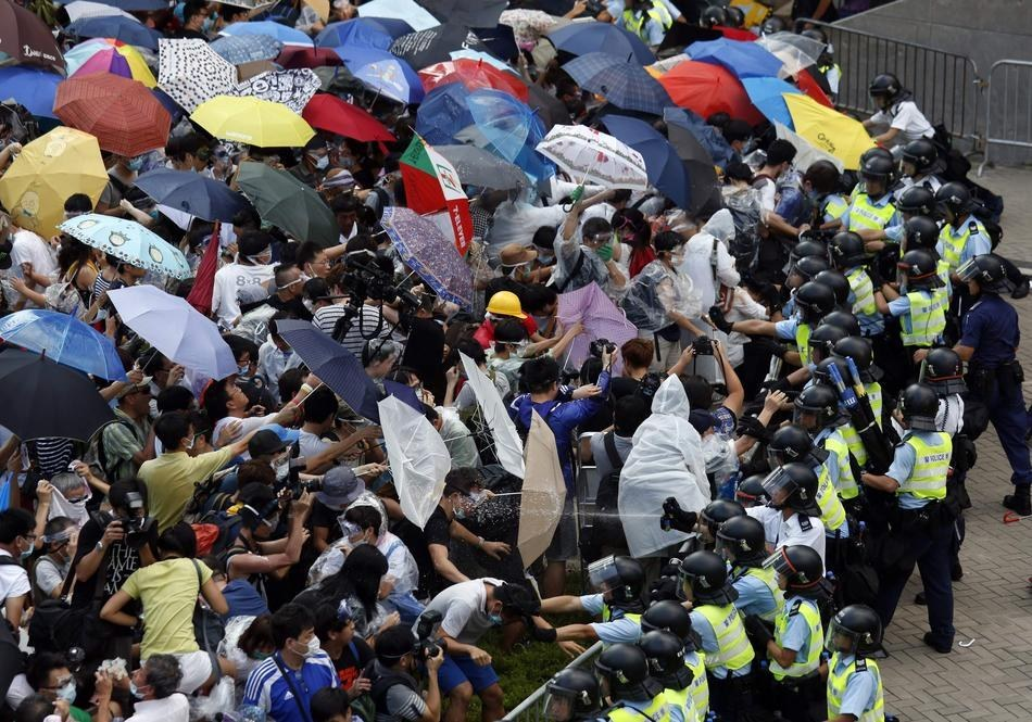 Umbrellas are used by the protesters as a means of protecting themselves against tear gas and pepper spray.