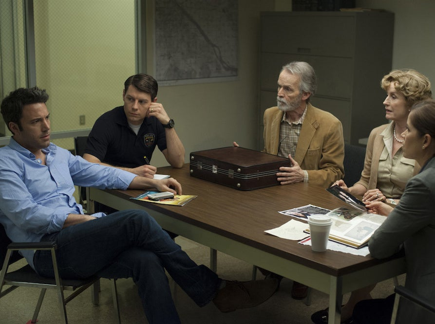 Ben Affleck, Patrick Fugit, David Clennon, Lisa Barnes, and Kim Dickens in Gone Girl.
