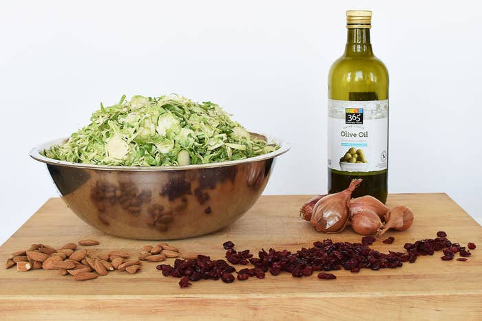 4 lbs Brussels sprouts *¼ cup olive oil5 large shallots½ cup raw almonds½ cup dried cranberries*(the Brussels sprouts shown above are already shredded, but you will buy them whole. Instructions on how to shred them are below.)