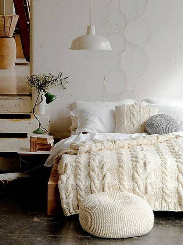 Dress your bed in a giant sweater with a cable knit blanket. 17 Ways To Make Your Bed The Coziest Place On Earth