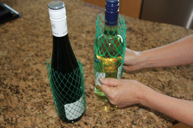 Plastic mesh sleeves around bottles of wine and liquor