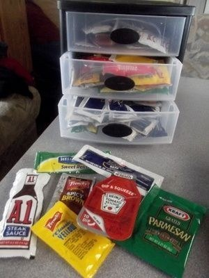 Plastic container full of free condiment packets