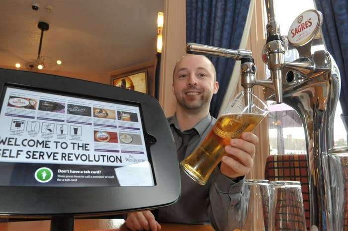 He's just added a £20,000 innovation. The Westbourne is, apparently, Britain's first iPub. What happens is this: There are a bunch of iPads fixed to the tables. Drinkers buy a special card which they place on the iPad sensor, and then...and THEN...