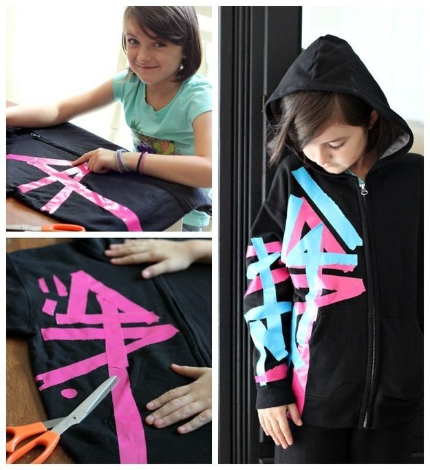 Make your own Wyldstyle costume using colored tape on a black hoodie and hair chalk.