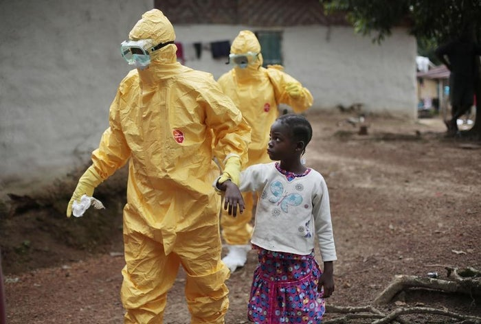 Nowa Paye, 9, is taken to an ambulance after showing signs of the Ebola infection in Liberia.