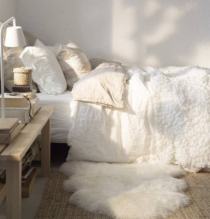 Interior Fur Bed Sheets 17 ways to make your bed the coziest place on earth 5 throw down an extra fuzzy bedside rug things easier for feet in morning