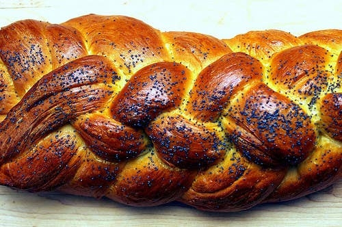 Sure you can buy your Shabbat challah at the supermarket, but you can also make this delicious egg bread yourself at home, if you leave yourself 3–4 hours to do it. The perfect challah is crispy and golden on the outside and fluffy on the inside. You can make it with a bread machine (see recipe #5) or without one, you can add raisins or even chocolate chips. But whatever you do: Make extra. Challah freezes really well and also makes for some delicious Saturday morning French toast. For help with your braiding technique, watch this video.