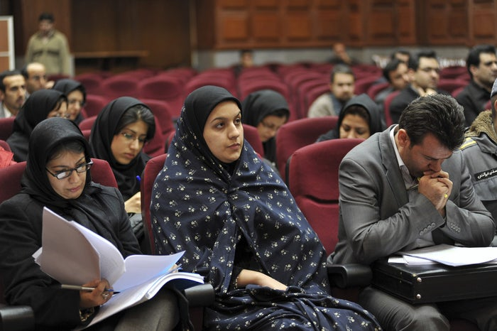 Iranian Reyhaneh Jabbari, center, sits while attending her trial in a court in Tehran, Iran.