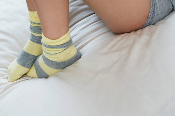 Apply peppermint moisturizer or Vaseline to your tired and cracked feet, and then throw on some comfy, cushioned socks. And head to bed. That's IT. Wake up with soft, smooth feet.