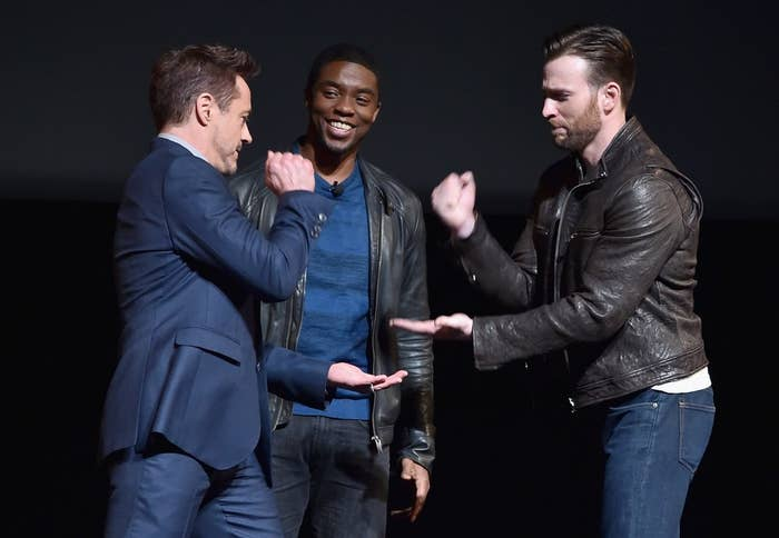 Robert Downey Jr. (i.e. Tony Stark) and Chris Evans (i.e. Steve Rogers) play Rock, Paper, Scissors for the loyalty of Chadwick Boseman (i.e. T'Challa) at the Marvel Studios event on Tuesday, Oct. 28