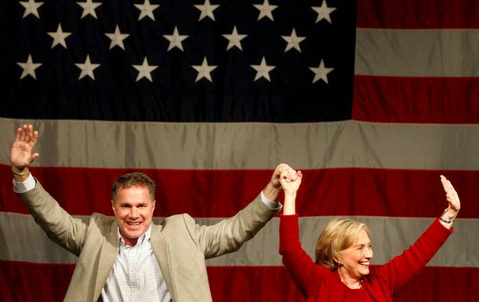 Hillary Rodham Clinton and Rep. Bruce Braley wave to supporters during a campaign event for his senate race on Wednesday in Davenport, Iowa.