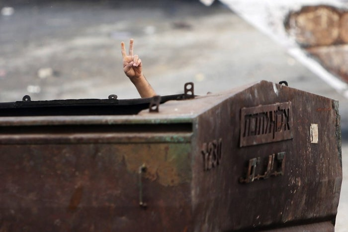 A Palestinian protester gestures during clashes in Jerusalem Thursday.