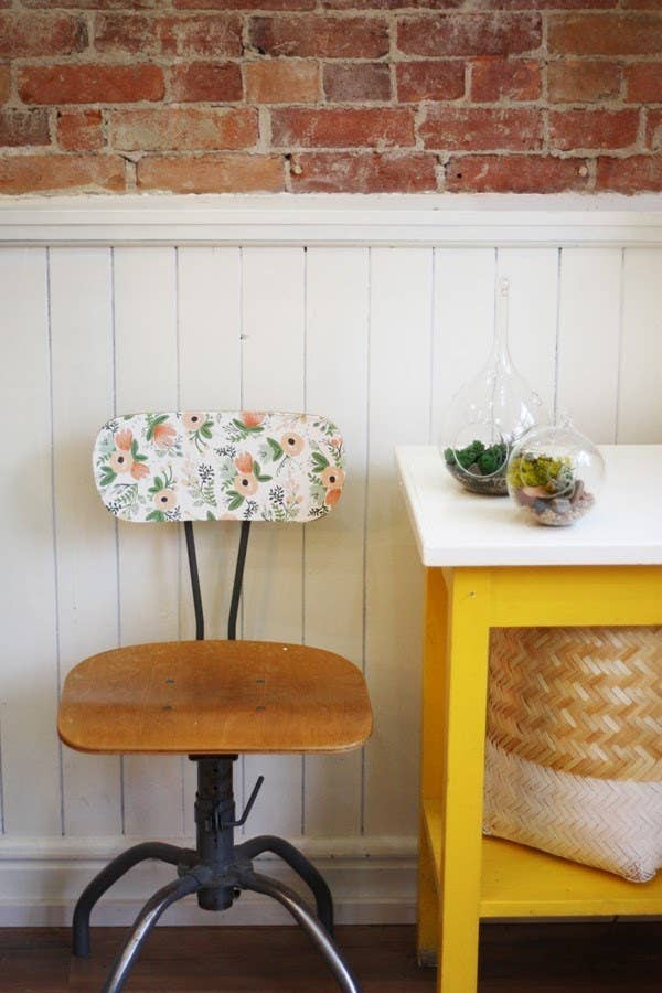 Apply wallpaper (or gift wrap from Rifle Paper Co.) to part of an old chair and give it a second life. Get the tutorial here.