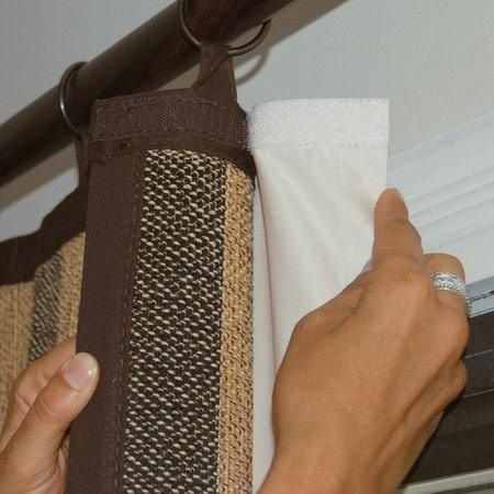 Velcro on black-out cloth material attached to RV curtain windows
