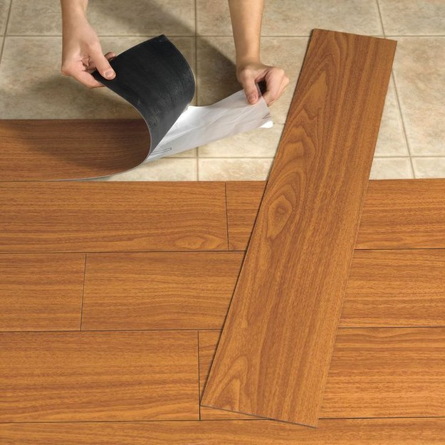 Laminate/vinyl flooring covering an old linoleum floor