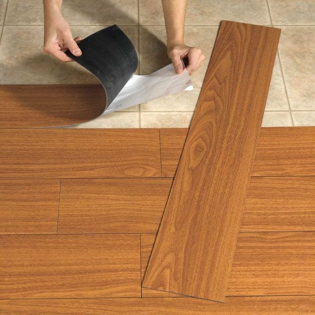 It's easy to install because you can cut the planks with a utility knife, they come pre-glued, and they're waterproof to boot.