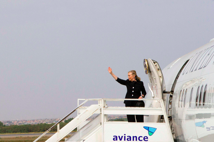 Hillary Clinton boards a plane on a trip as secretary of state in 2012.