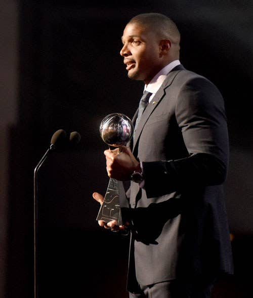Michael Sam accepts the Arthur Ashe Courage Award onstage during the 2014 ESPY Awards in Los Angeles.