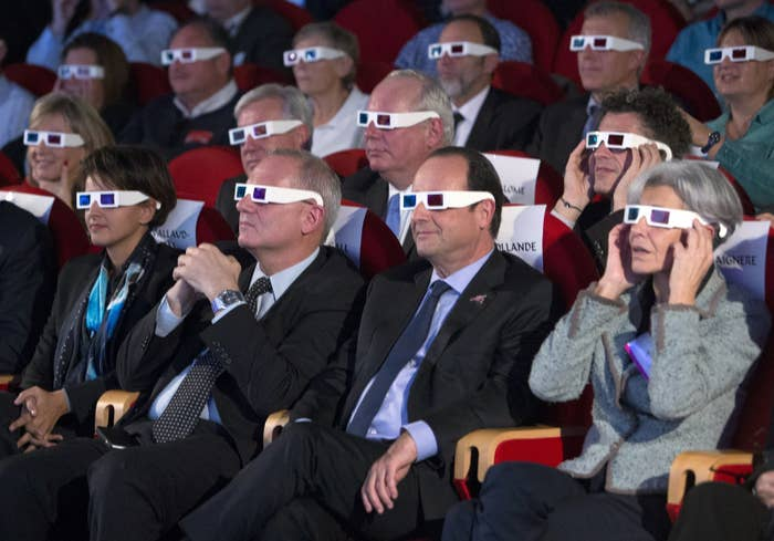 (L-R) French Education Minister Najat Vallaud-Belkacem, National Centre for Space Studies (CNES) president Jean-Yves Le Gall, French President Francois Hollande, and former French astronaut and minister Claudie Haignere wear 3D glasses to view the first results of the Rosetta mission on the 67P/Churyumov-Gerasimenko comet at the Cite des Sciences in Paris on Nov. 12.