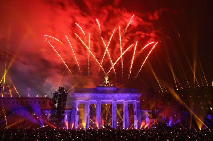 Fireworks illuminate the Brandenburg Gate during celebrations on the 25th anniversary of the fall of the Berlin Wall on November 9, 2014 in Berlin, Germany.