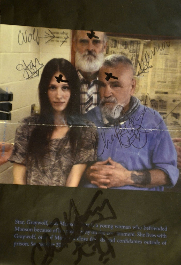 Charles Manson, right, autographed a photo in 2013 of himself with Star, and a friend, for one of his correspondents.