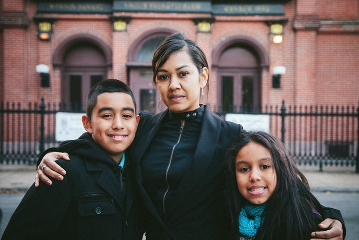 Angela Navarro and her two children in front of West Kensington Ministry in North Philadelphia, where she will seek sanctuary from deportation.