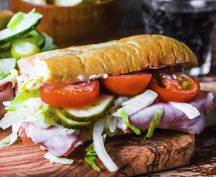 """Although it is certain the Hoagie comes from Philadelphia, there are still several versions of how the sandwich first came to be. One famous theory is that the term """"Hoagie"""" refers to the men who worked on Hog Island. Hog Island was famous for shipbuilding and the shipbuilders liked their sandwiches big, so the local shopkeepers decided to create a custom sandwich that would be able to satisfy their appetites."""