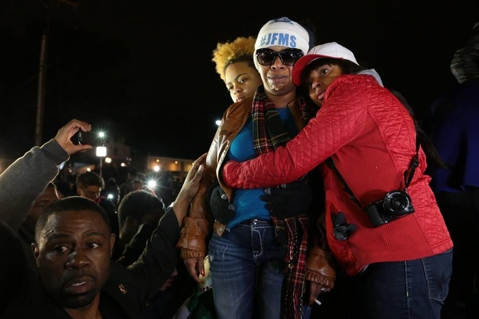 Lesley McSpadden being comforted outside the Ferguson Police Department on Monday night.