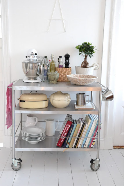 Use one as a kitchen cart to store small appliances and cookbooks.