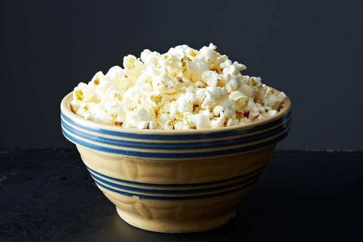 When you're craving a salty snack, homemade popcorn is the perfect solution. It's super-easy to make, can be flavored according to your whim, and it's healthier and cheaper than the movie-theater or microwaveable kinds. In this recipe for stovetop popcorn, spritz some water on the popcorn instead of pouring melted butter over it, and then sprinkle with salt. It will still be delicious with a lot less fat. (And btw, you can also just make it in a paper bag in the microwave.) Once you've mastered the basics, feel free to spice things up with different flavors. And if you're a big snacker, consider making space in your kitchen for an air popper.
