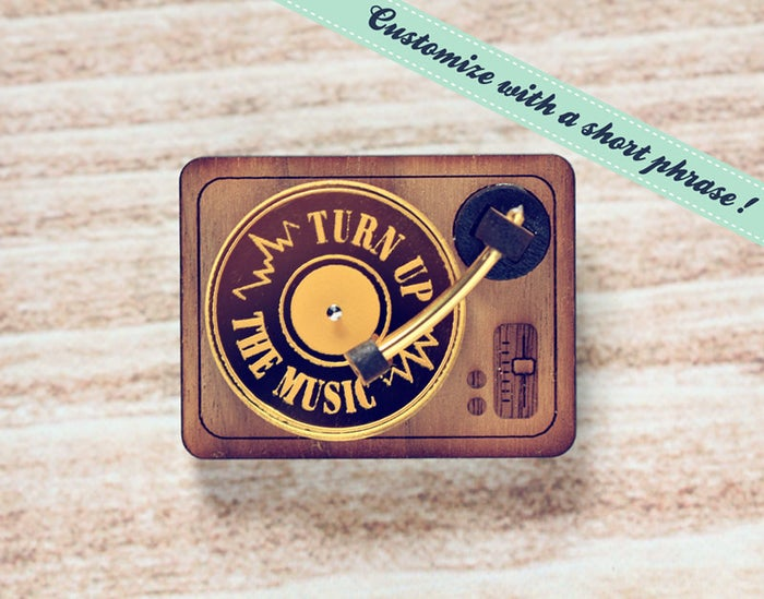 The tiny little record (that actually spins!) can be engraved with a short message.